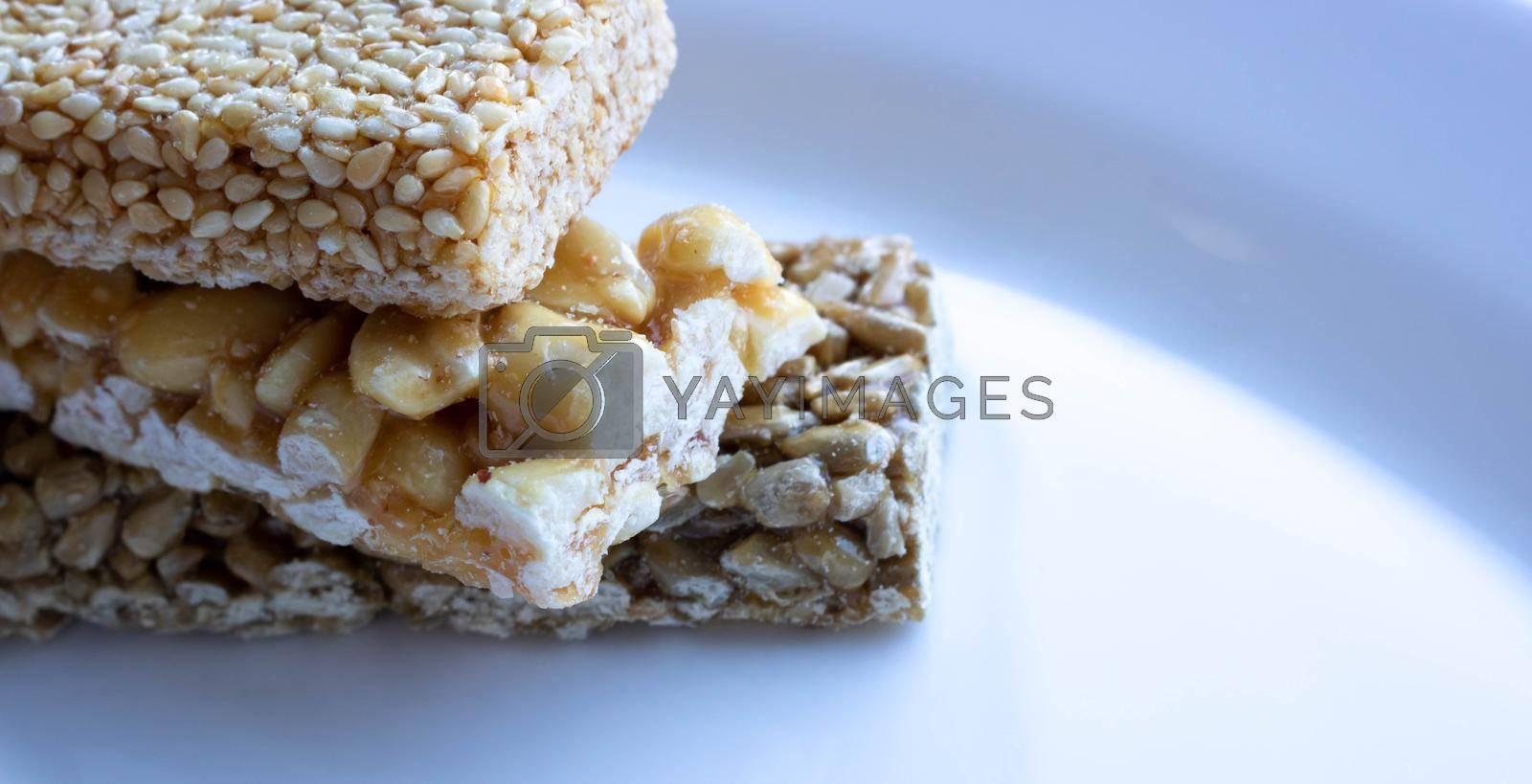 Delicious Honey kozinaki on a white plate.