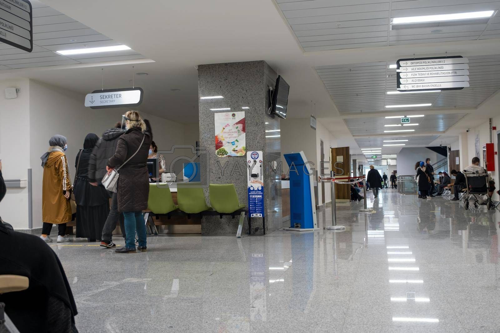 wide angle of hospital in pandemic days and patients walking around in Turkey