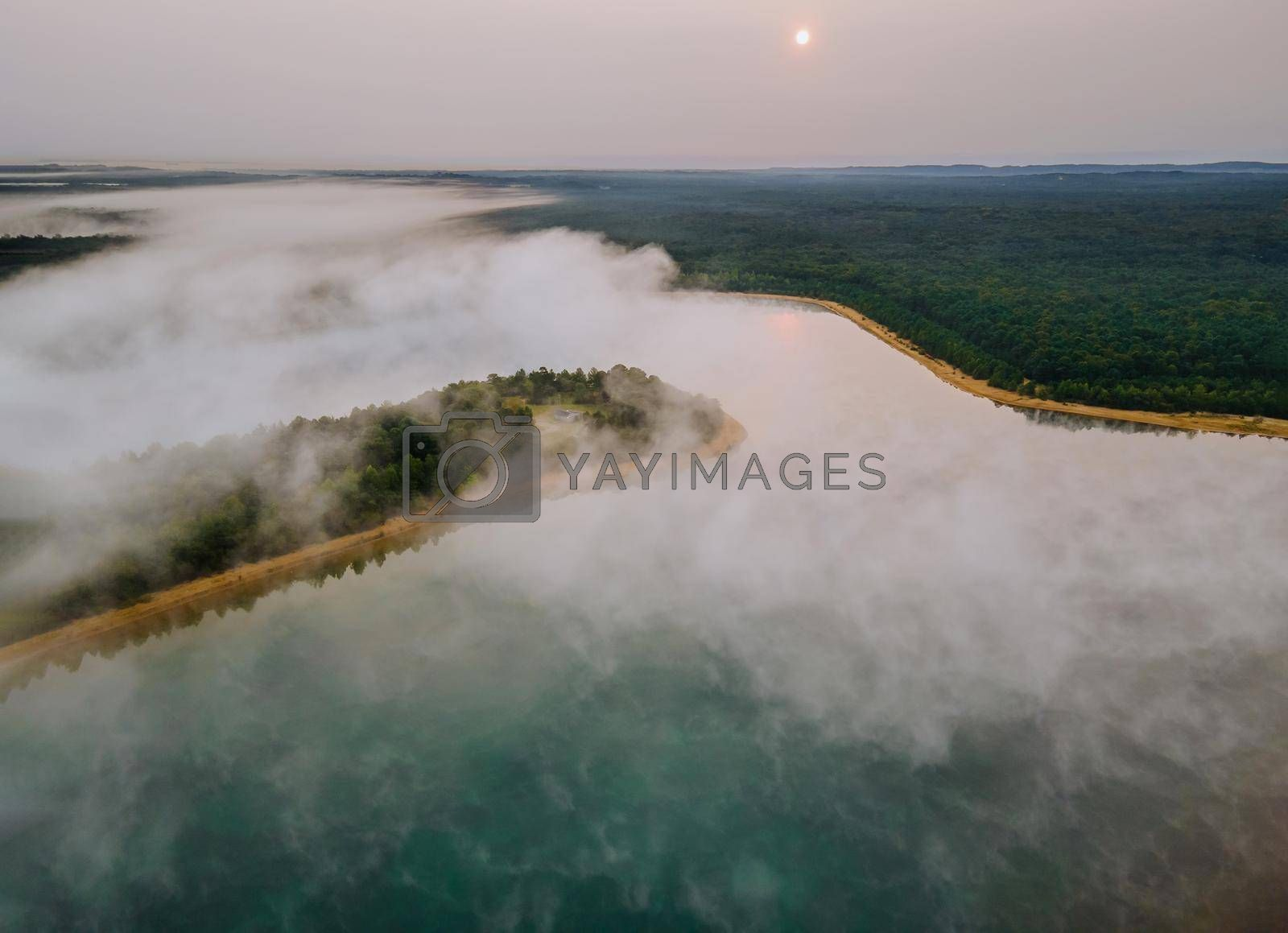 Aerial view on morning on the lake, sunrise of foggy trees