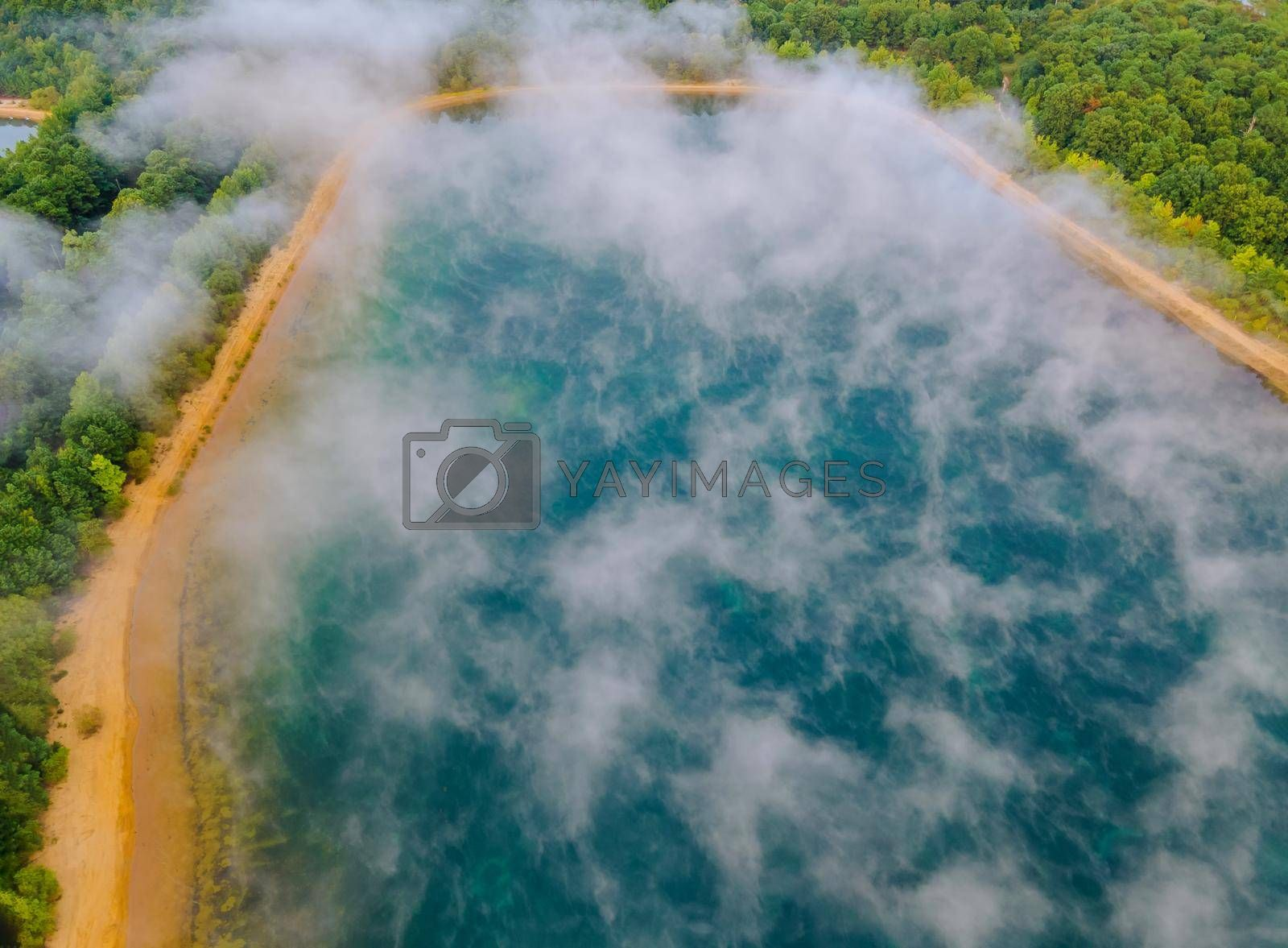 Morning mist landscape fog over autumn lake water aerial view