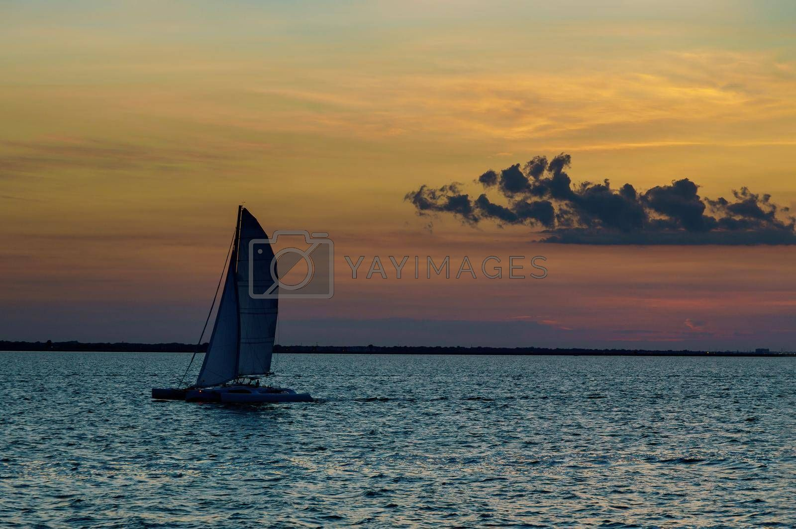 Holiday lifestyle landscape with skyline yacht sailing against sunset sailboat romantic trip on the ocean maritime evening walk during sunset.