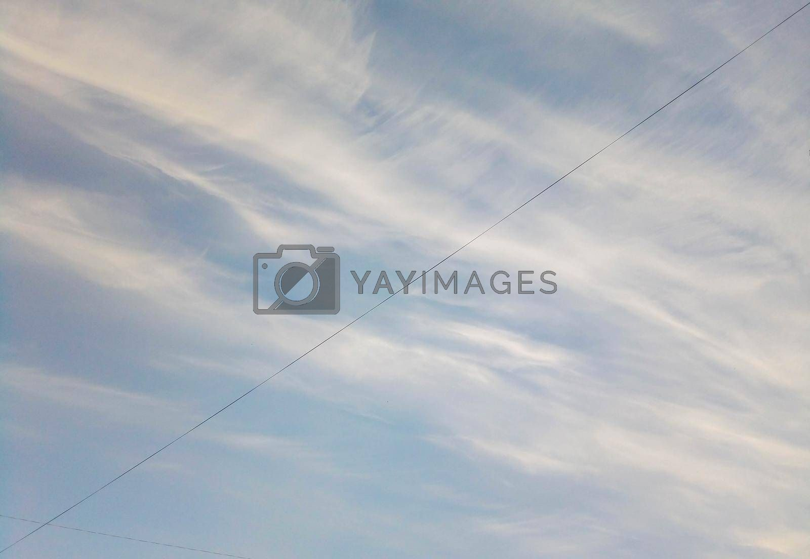 Blue sky with clouds and electric wire.