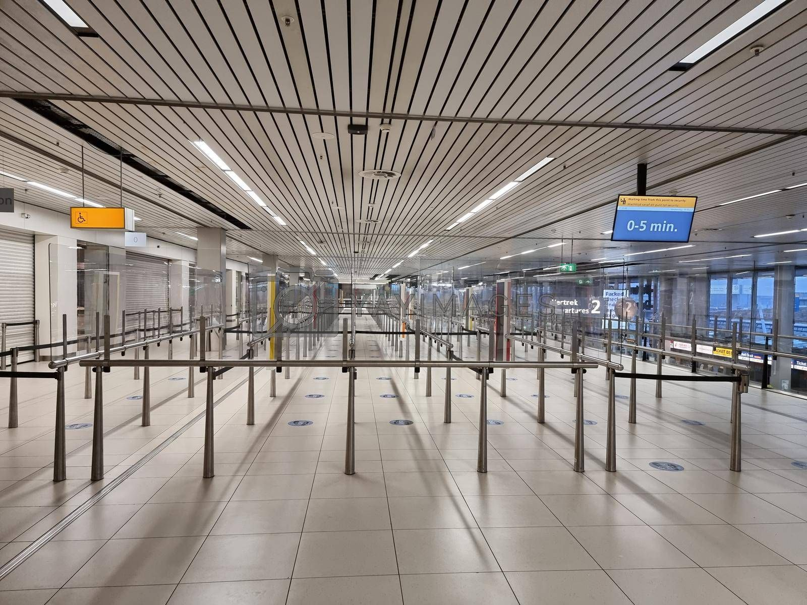 Amsterdam Netherlands March 2021, empty terminal at Schiphol airport Amsterdam during covid 19 corona outbreak pandemic in the world. Empty airport Amsterdam Schiphol
