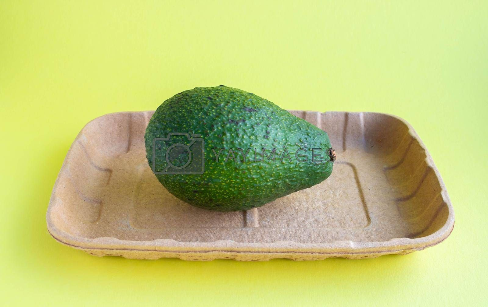 Avocado close-up on eco-backing . Natural fresh organic exotic fruits. Healthy food, raw food. Vegetarian lifestyle. Proper nutrition. Eco-friendly product.