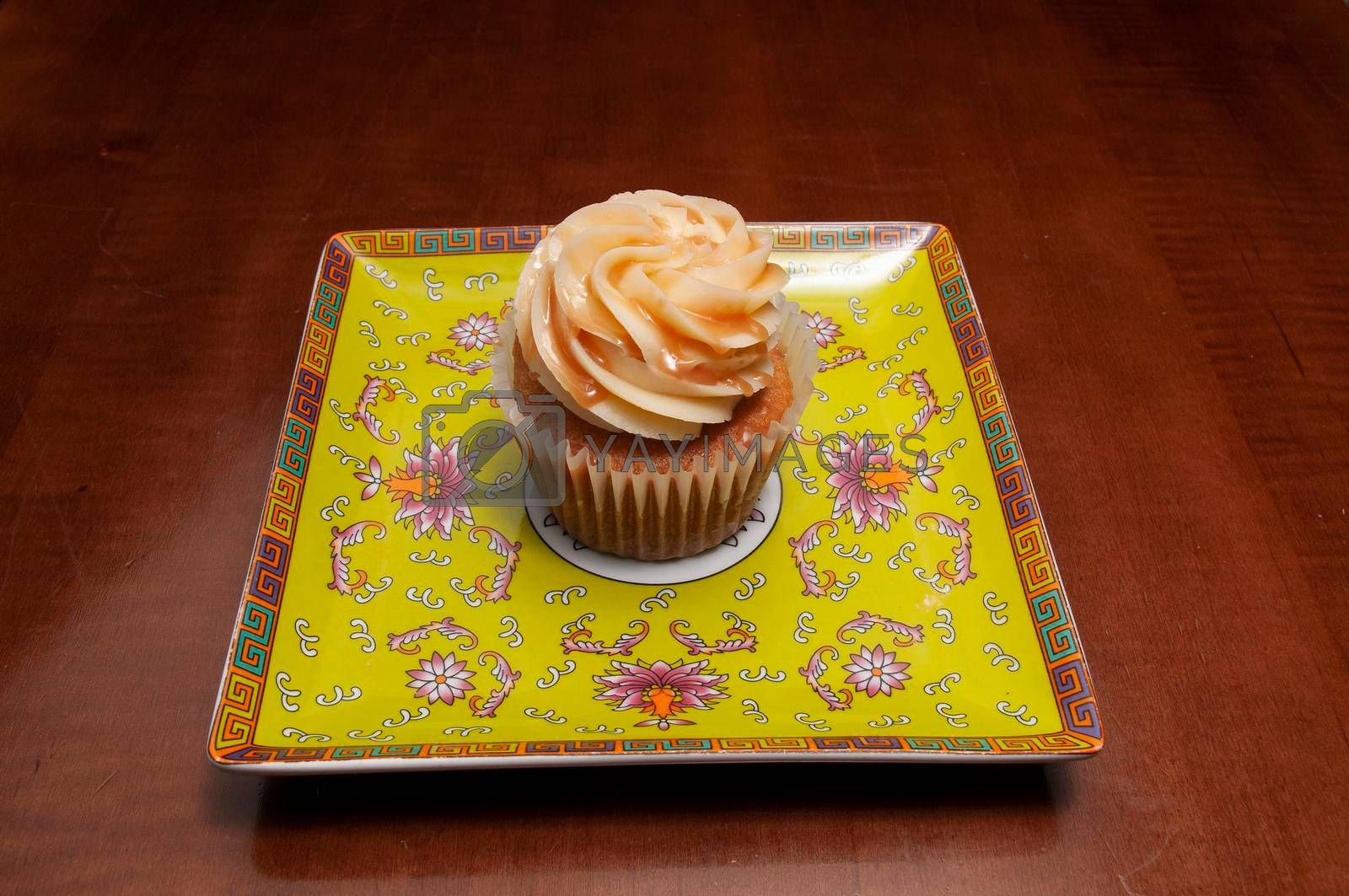 Delicious bakery product known as the vanilla with caramel cupcake