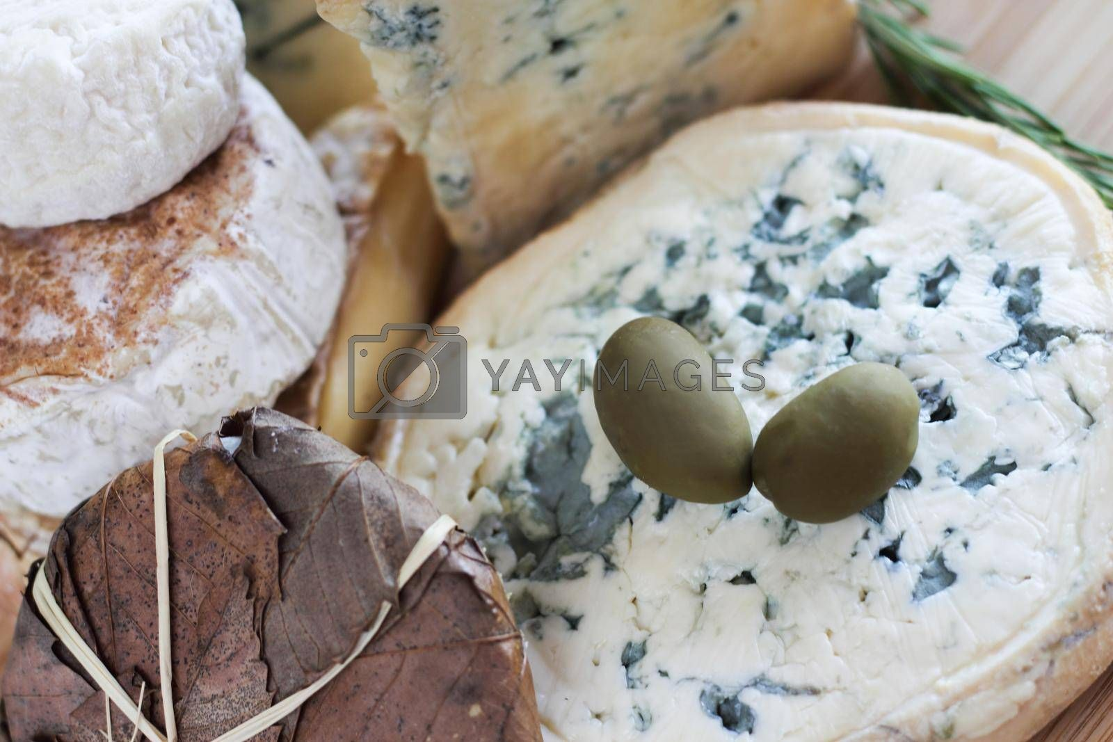 Blue Cheese assortment and Olives composition french cheese gourmet market