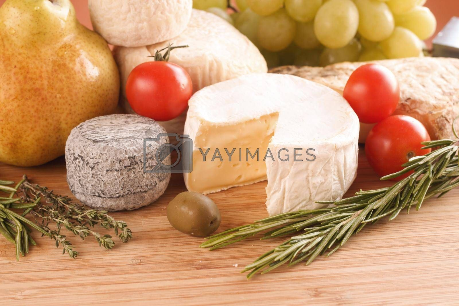 French cheese market assortment composition on wooden plank table
