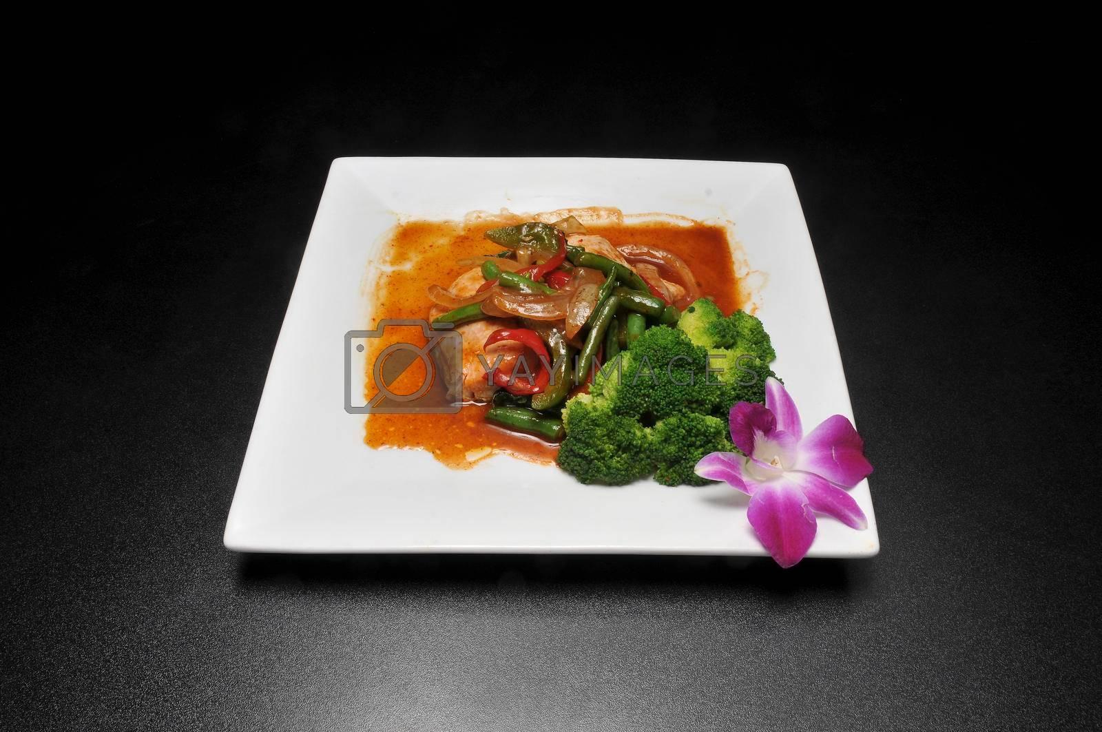 Delicious Thai food known as salmon basil