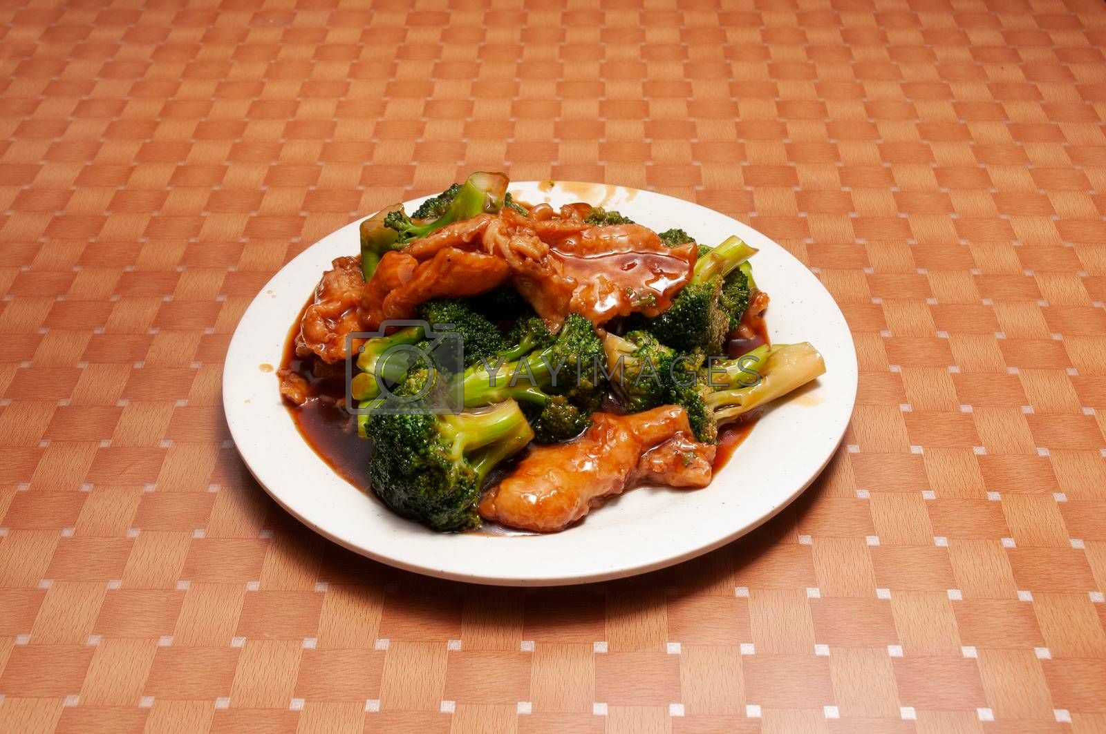 Traditional Chinese dish known as sweet and sour chicken with broccoli