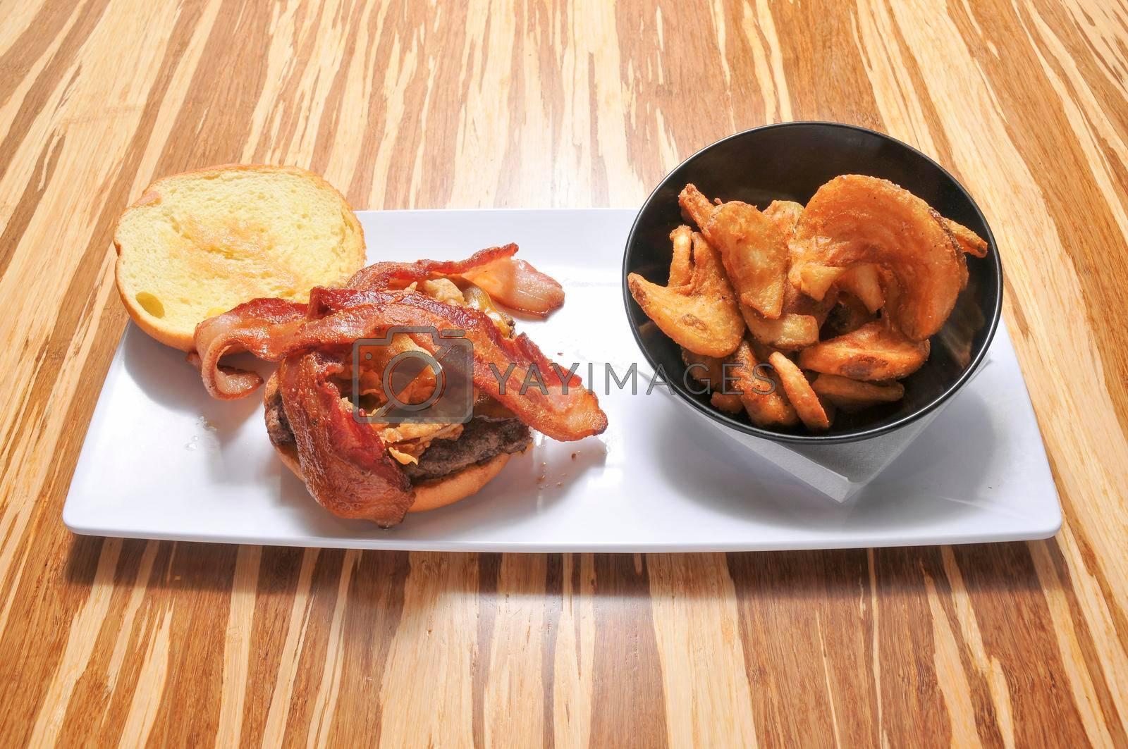 All American classic bacon cheeseburger on a sesame seed bun.