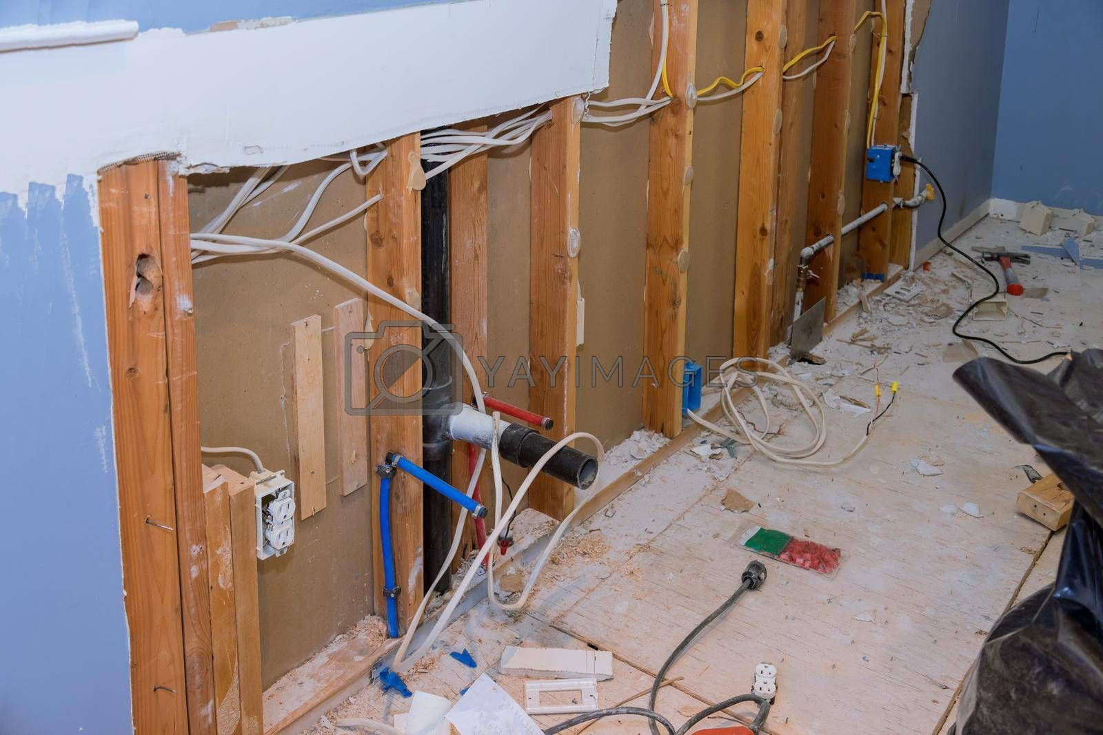 Kitchen remodel home improvement view with drywall demolition an interior wall