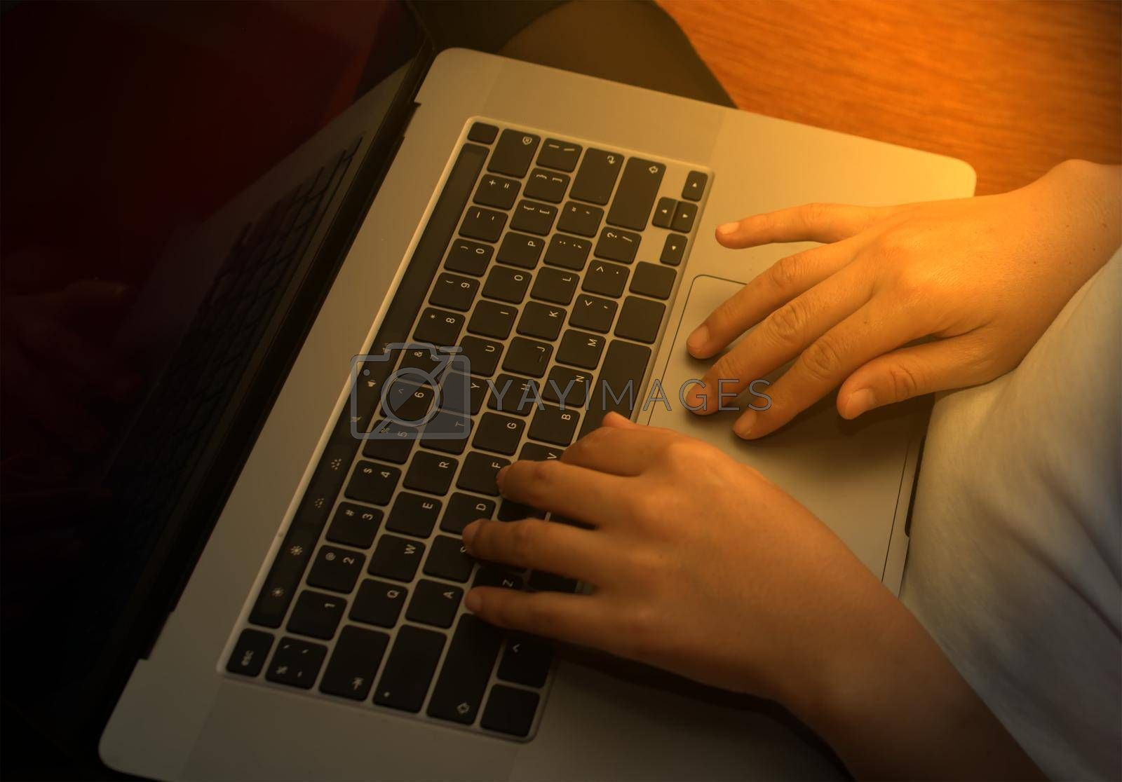 Girl hand typing laptop keyboard in concept coffee shop Wireless data entry and technology.