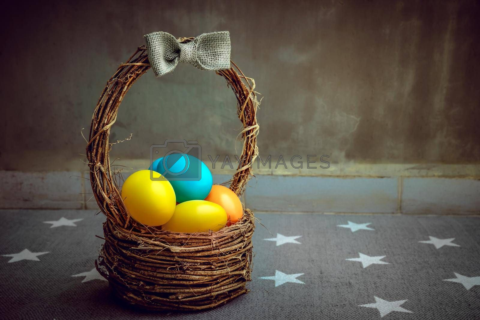 Beautiful Colorful Painted Eggs in the Basket at Home. Traditional Easter Decorations. Spring Christian Holiday.