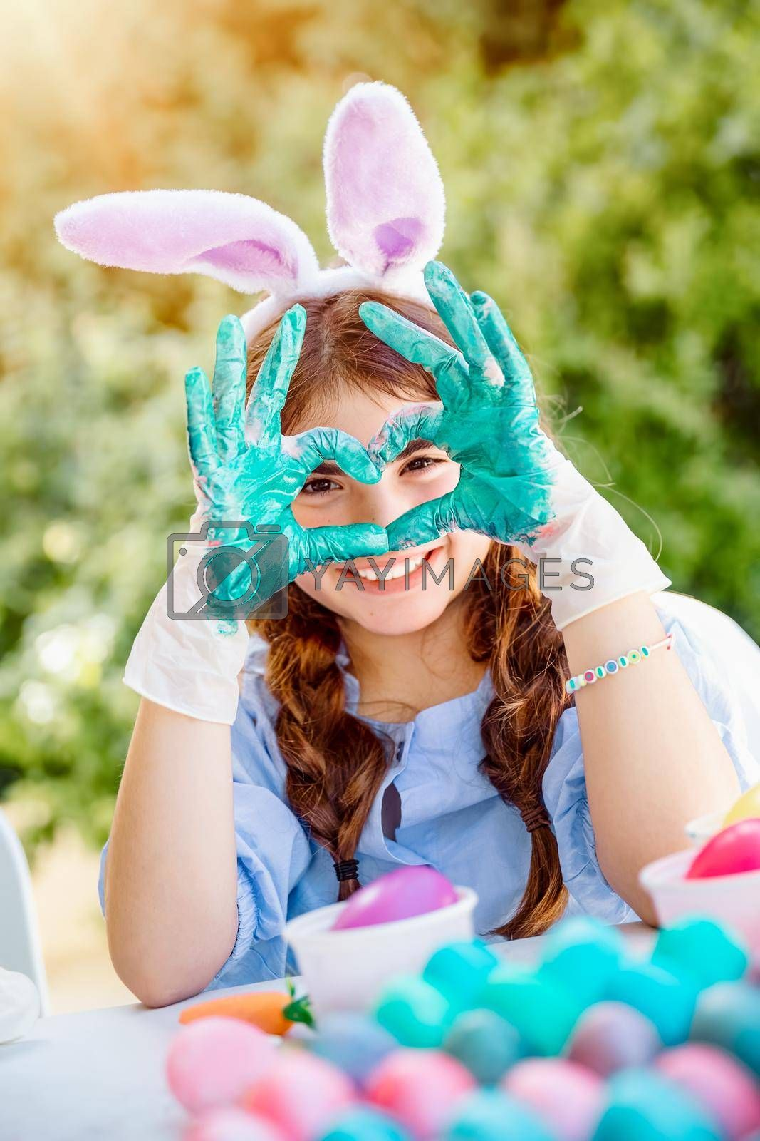 Royalty free image of Little Girl Paints Easter Eggs by Anna_Omelchenko