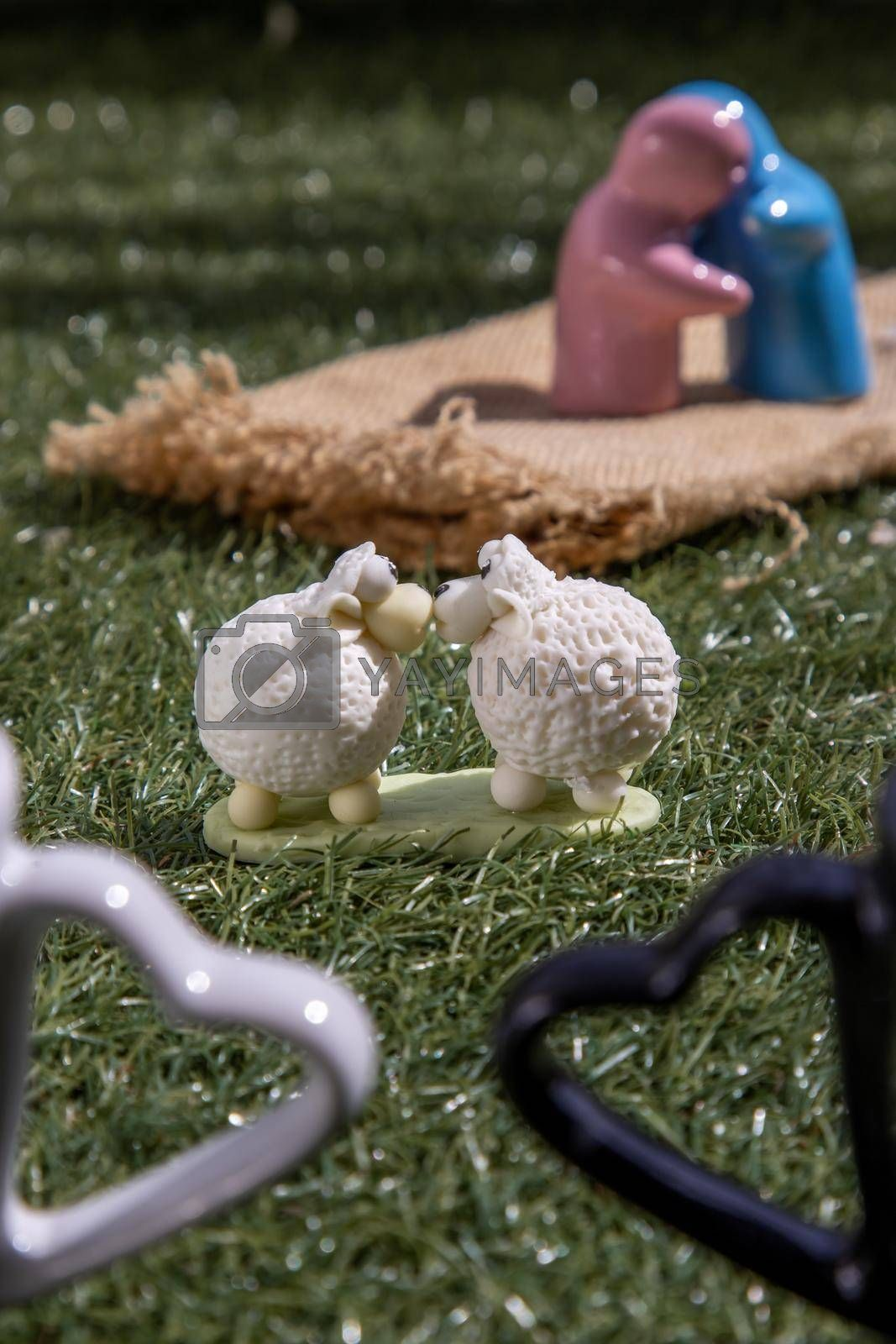 Ceramic couple dolls hug and Sheep ceramic couple dolls Kissing on lawn. Concept for anniversary, Wedding and eternal love concept, Romance wedding or Valentine's day.