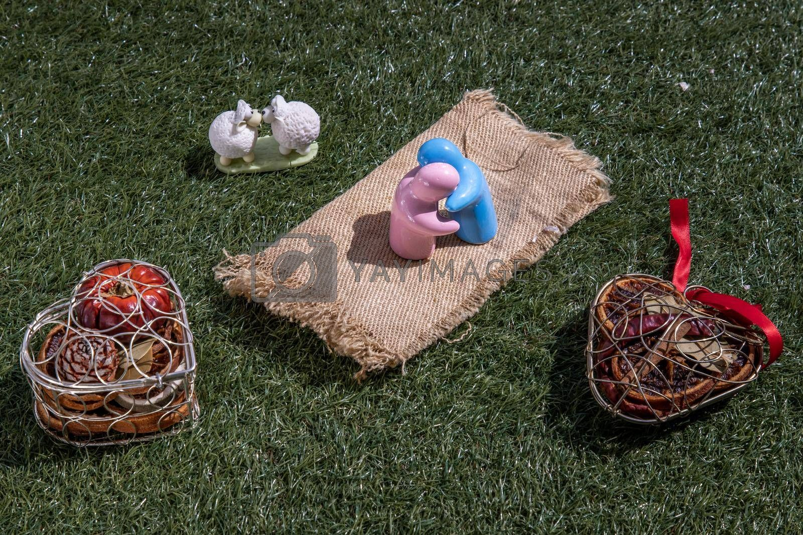 Sheep ceramic couple dolls Kissing and ceramic couple dolls hug on lawn. Concept for anniversary, Wedding and eternal love concept, Romance wedding or Valentine's day.