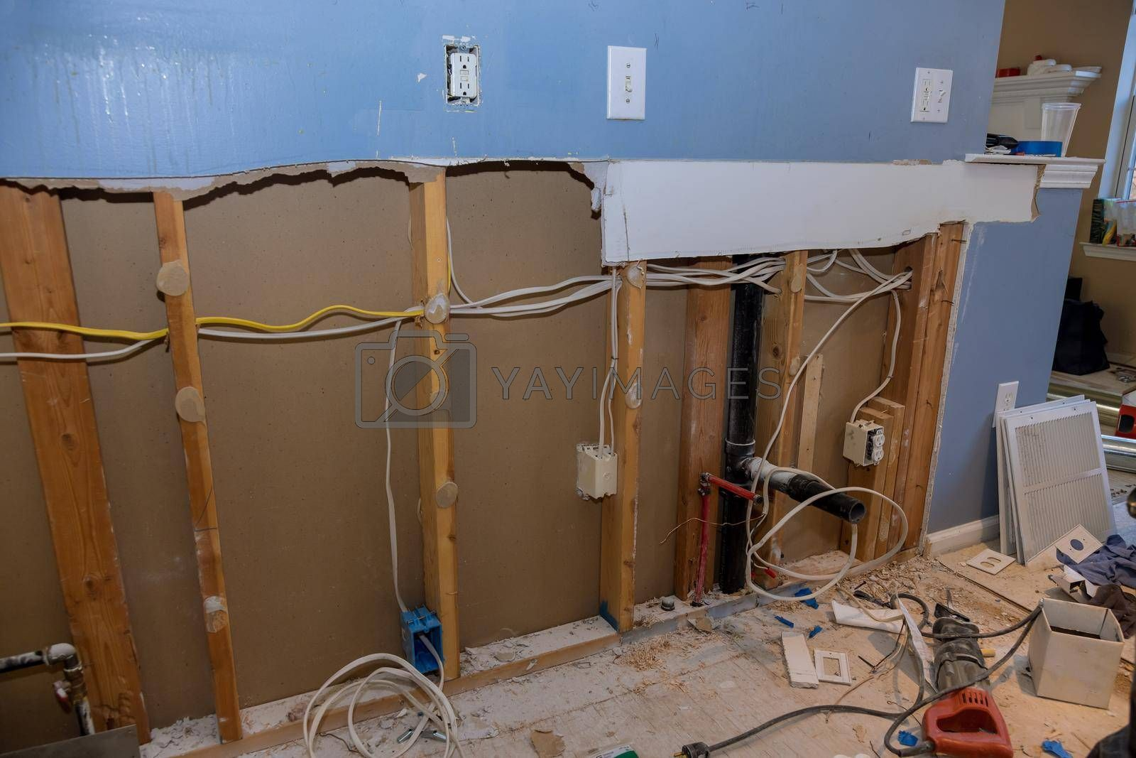 Materials for repairs and tools for remodeling in the kitchen that is under renovation, reconstruction with demolition old drywall