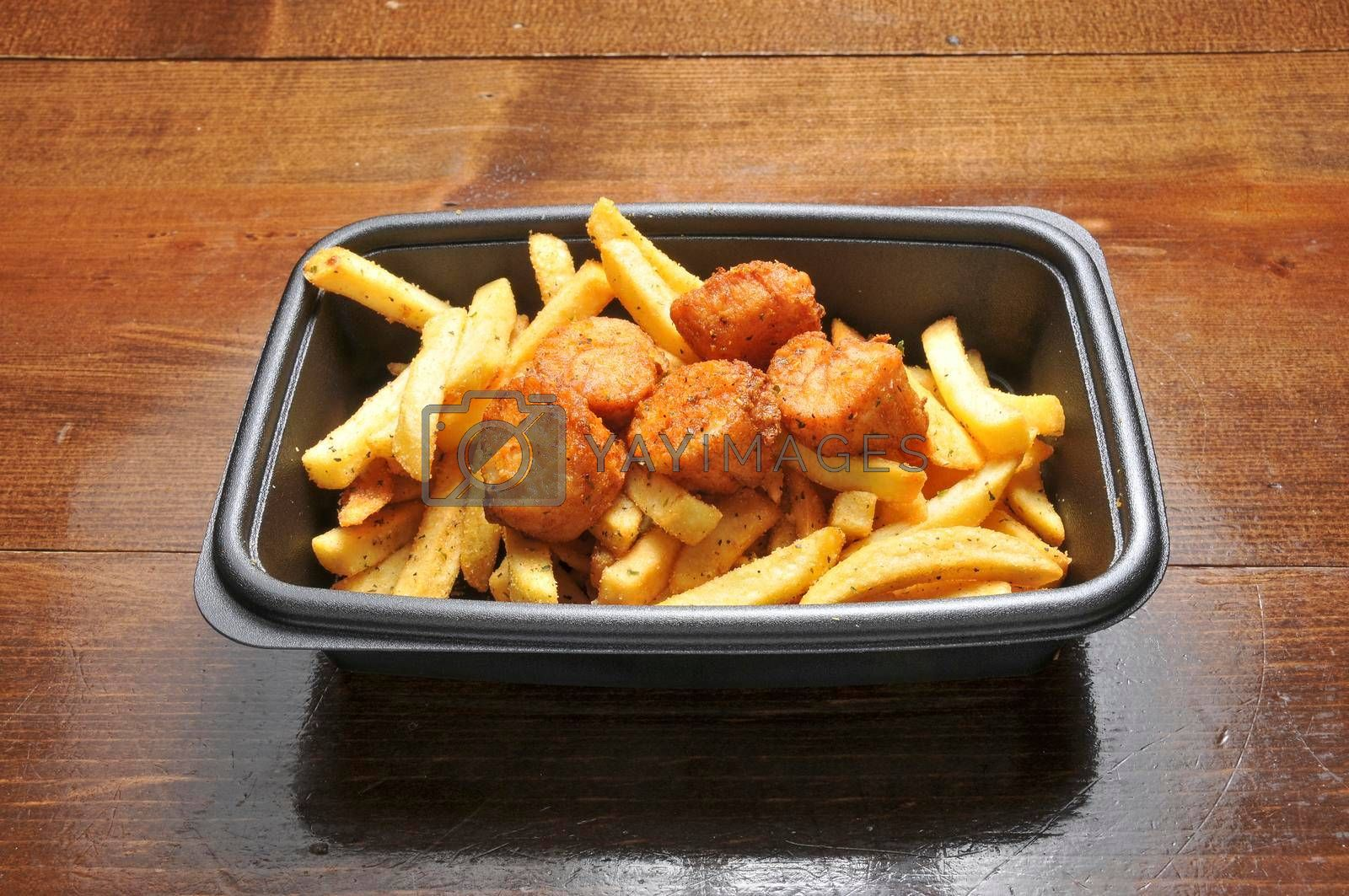 Delicious American cuisine known as fried scallops and french fries