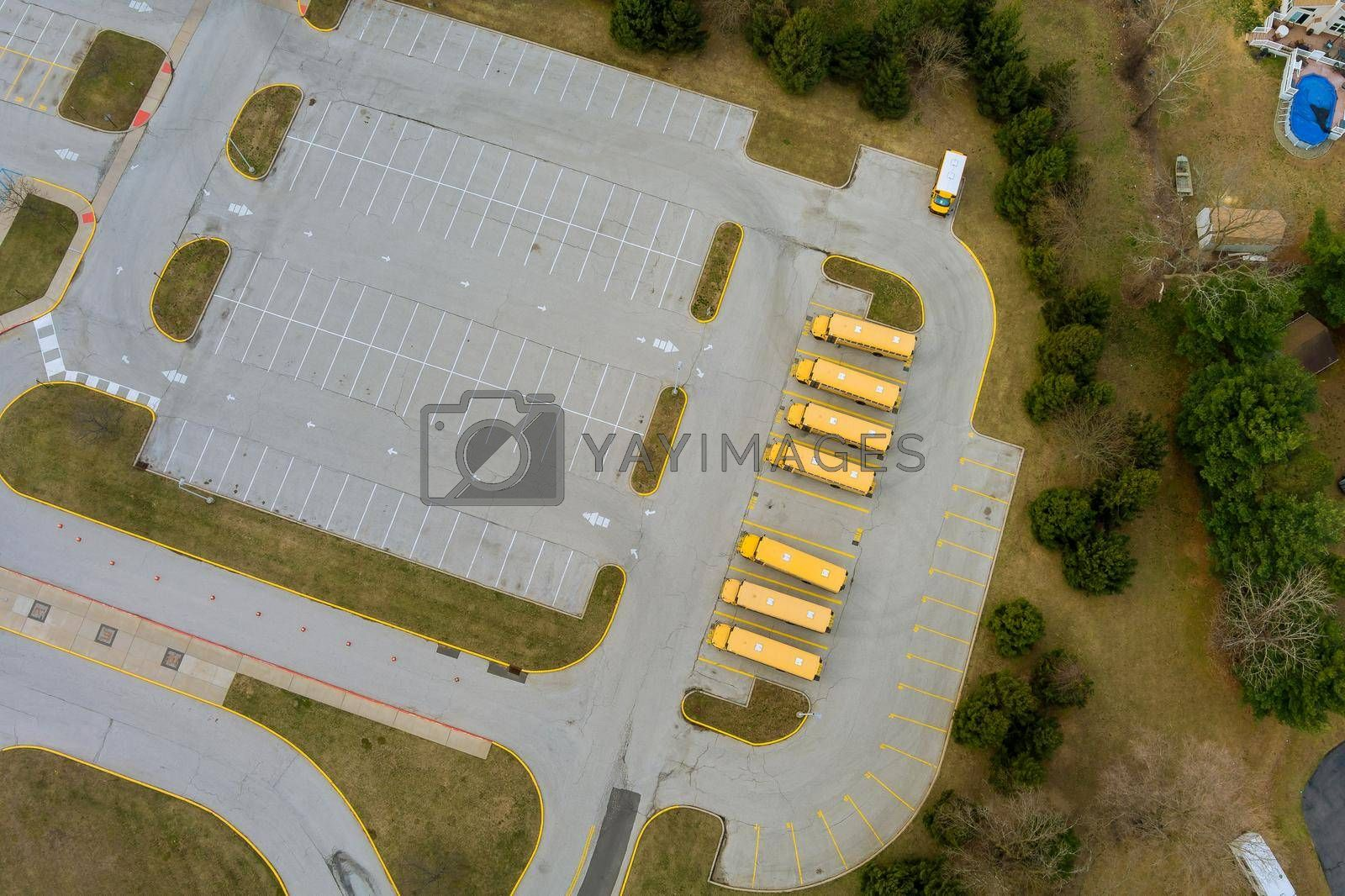 School buses in the school parking lot near the high school