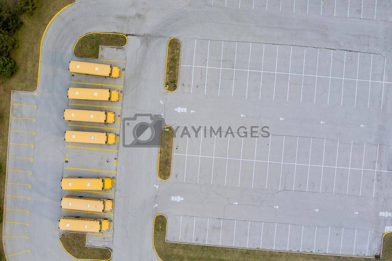 Aerial top view the yellow school buses parked near the high school