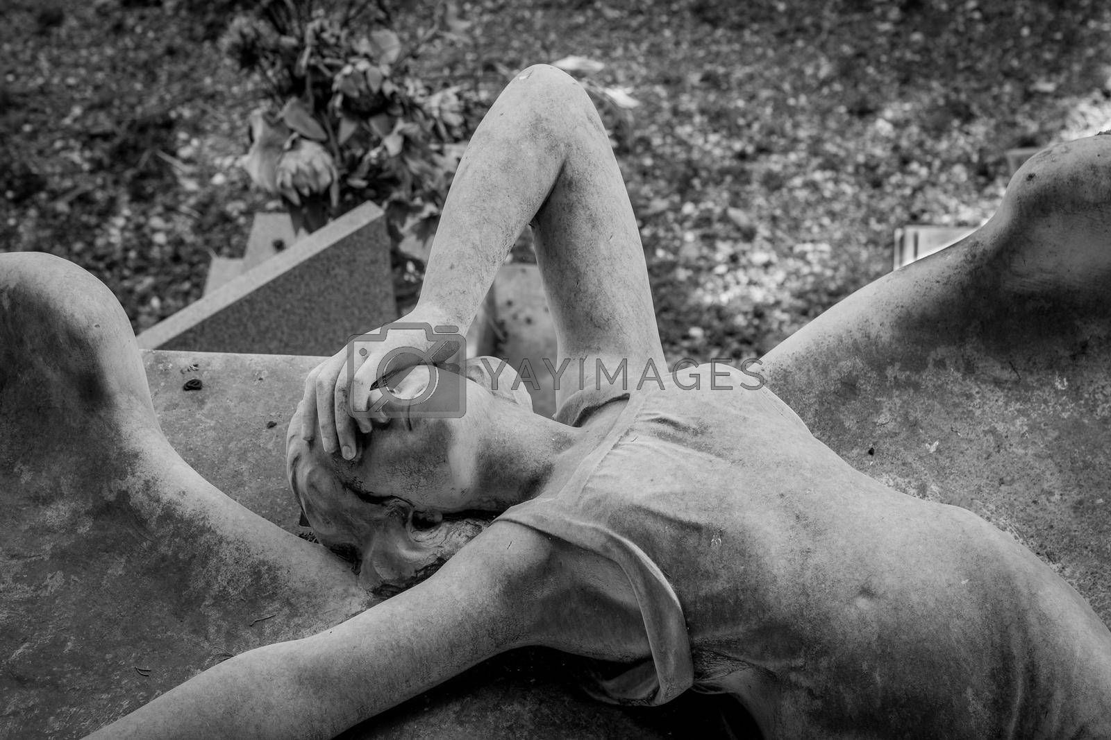 GENOA, ITALY - June 2020: antique statue of angel (1910, marble) in a Christian Catholic cemetery - Italy