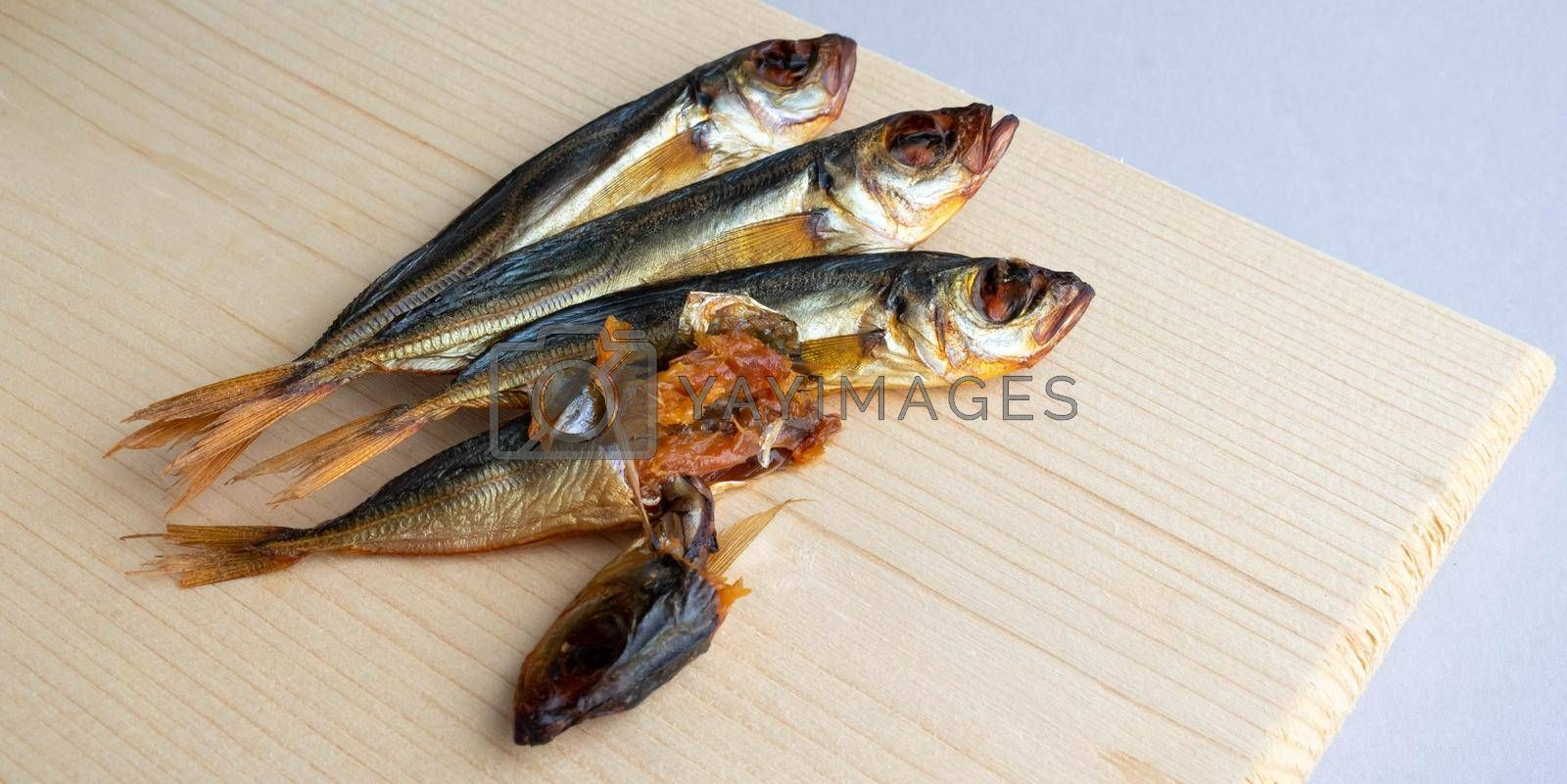 Royalty free image of Horse mackerel fish, cold smoked. Smoked fish close-up on a wooden background .Food industry by lapushka62