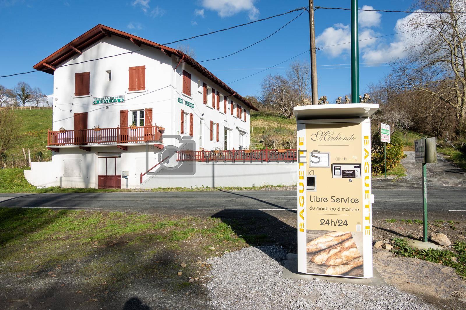 SUHESCUN, FRANCE - CIRCA DECEMBER 2020: Minhondo Bakery baguette vending machine.