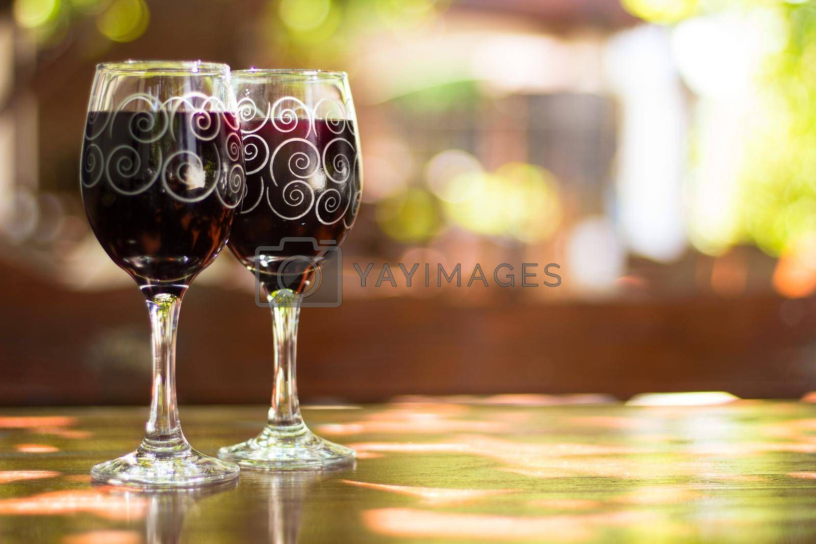 Two glasses of red wine on the table of outdoor cafe