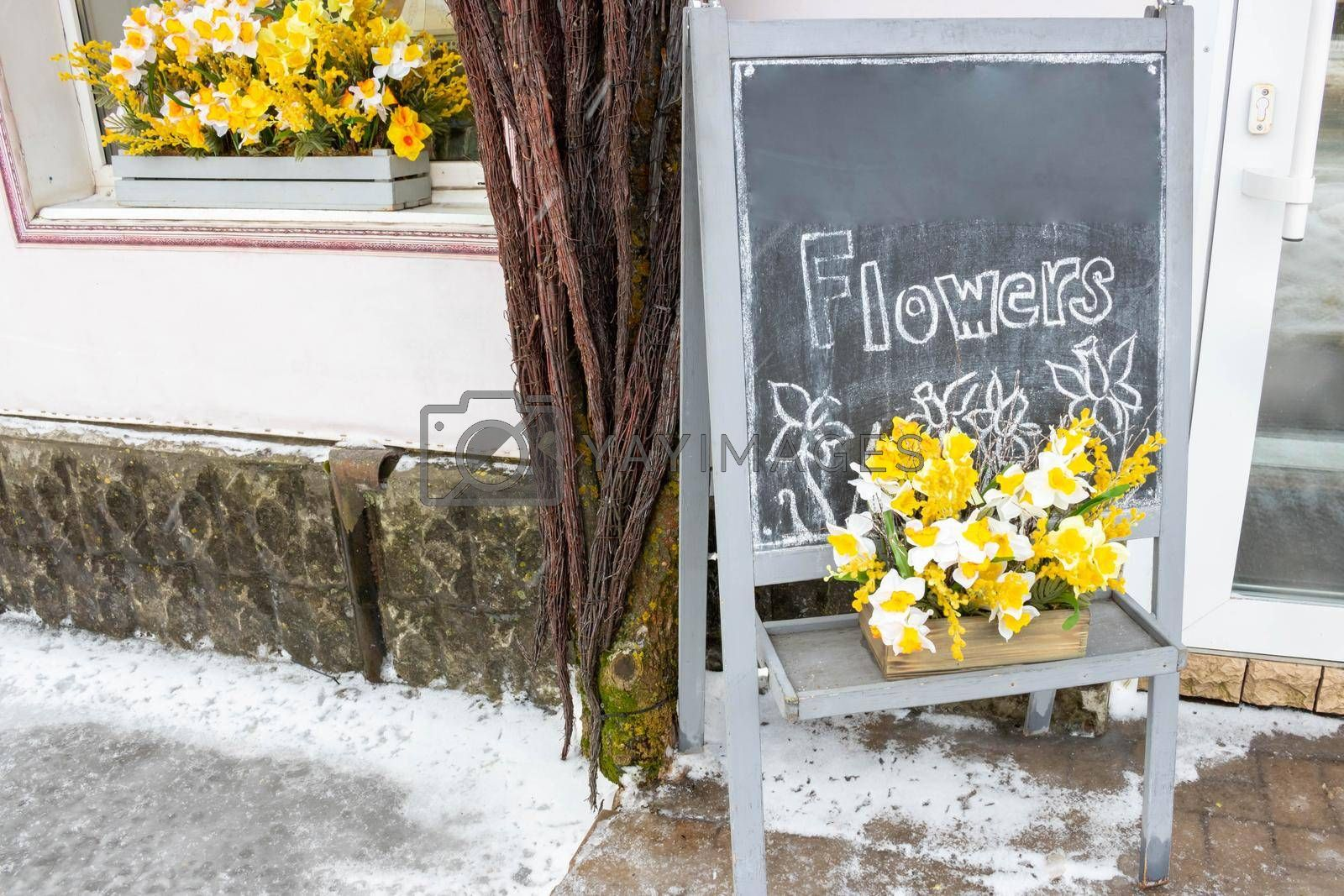 Royalty free image of A street billboard outside a flower shop.Advertising of flowers by lapushka62