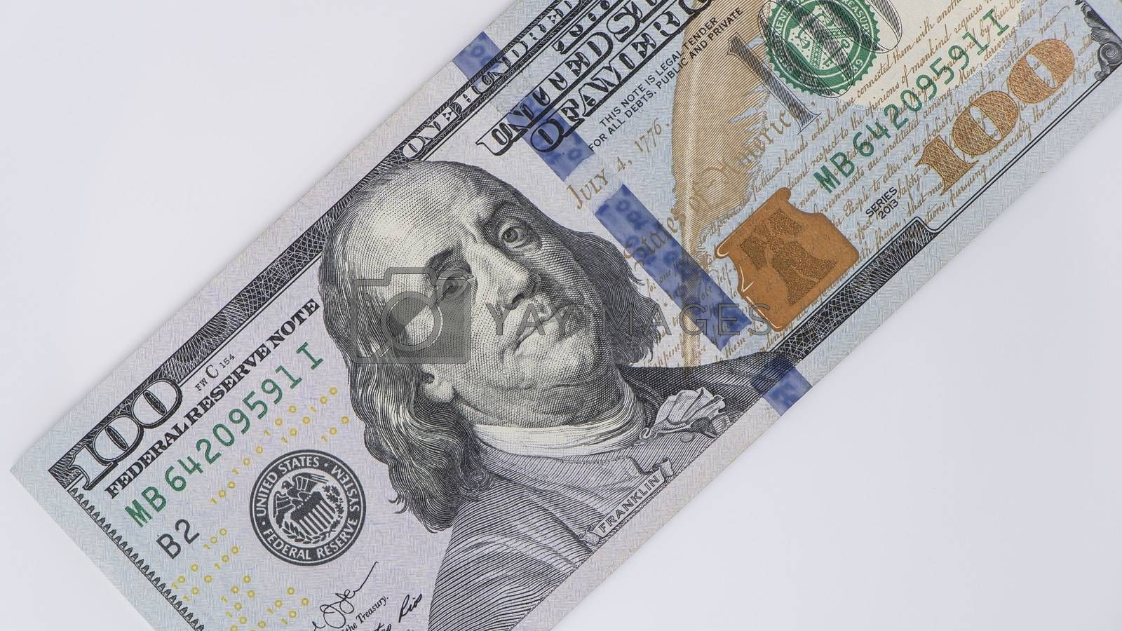 Dollars on white background.Sawing through America's budget, the living wage, or the dual currency basket in the US.The crisis by the fall in exchange rates.Dollar depreciation. Business and banking