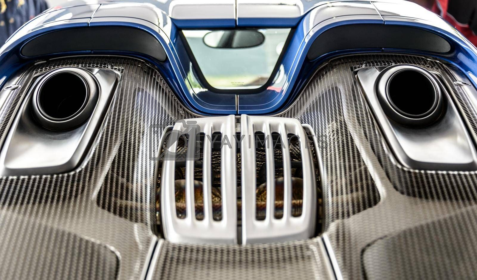 LONDON, UK - CIRCA JUNE 2014: Porsche 918 Spyder top mounted exhaust system and engine cover detail shot.