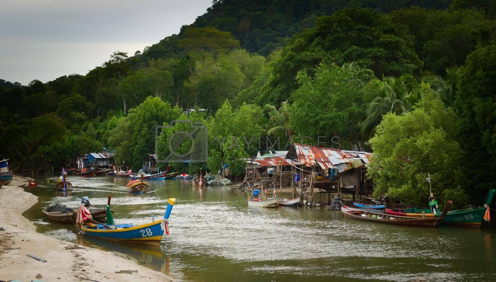 Royalty free image of 2019-11-05 / Phuket, Thailand - Wooden shacks by the river in a poverty stricken area of the town. by hernan_hyper