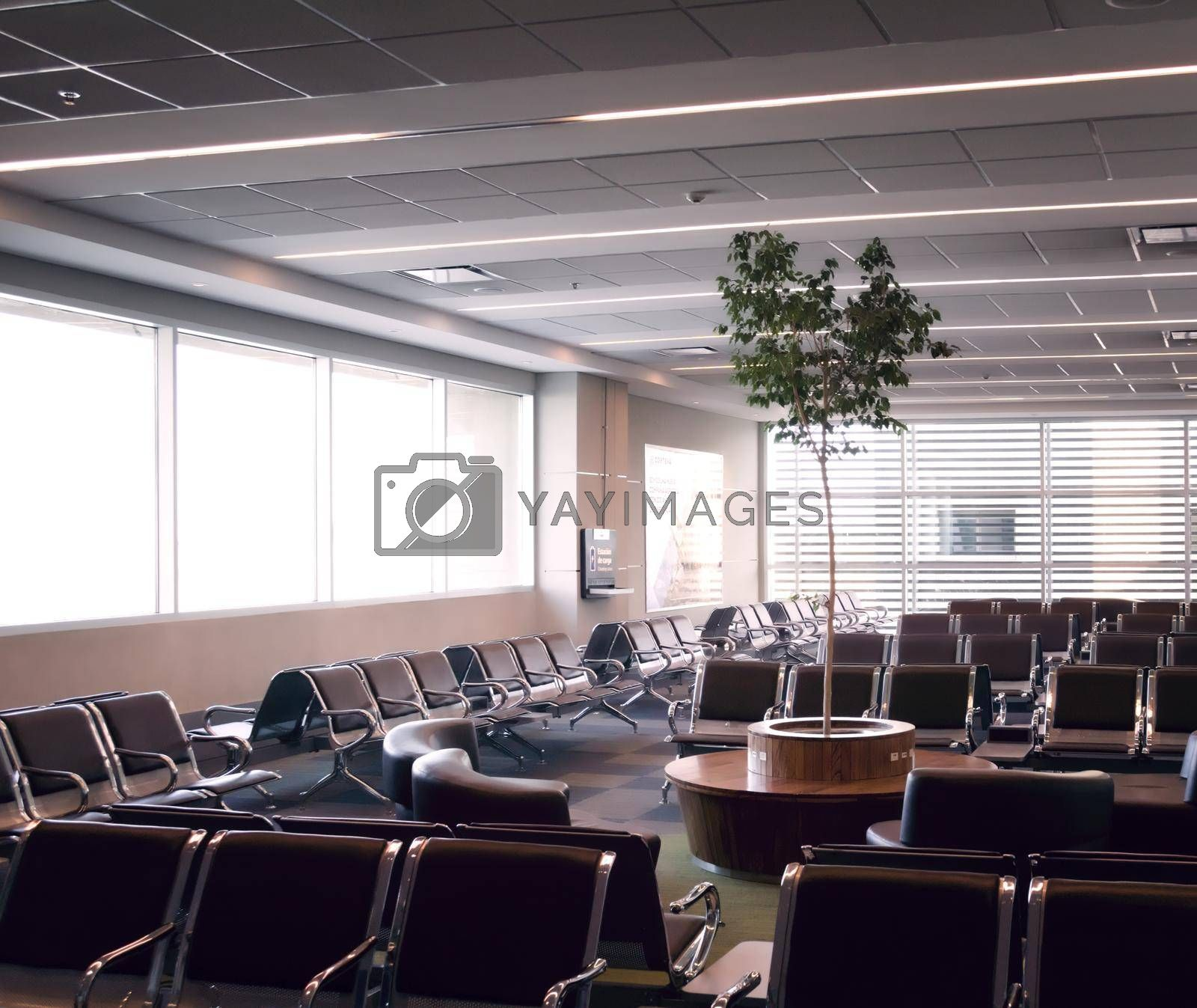 Royalty free image of Empty seats at the waiting area of an airport. by hernan_hyper