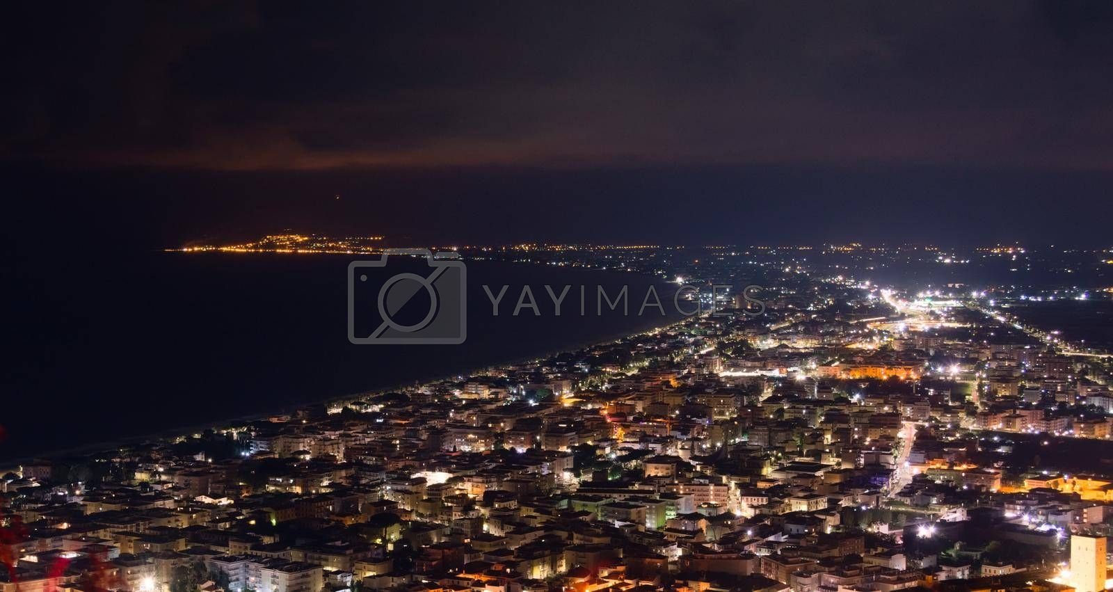 Royalty free image of Aerial night view of the city of Terracina, Italy, by the Mediterranean sea. by hernan_hyper