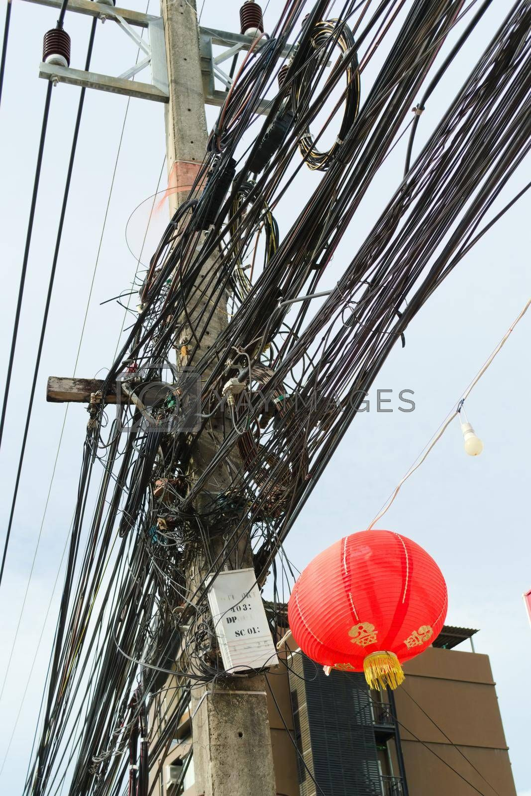 Royalty free image of Chaotic, messy cables on a pole in Phuket, Thailand. by hernan_hyper
