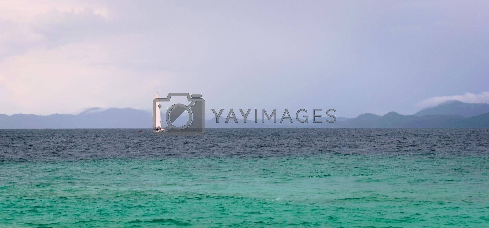 Royalty free image of Sailboat on the turquoise waters of Andaman Sea, near Phuket, Thailand. by hernan_hyper
