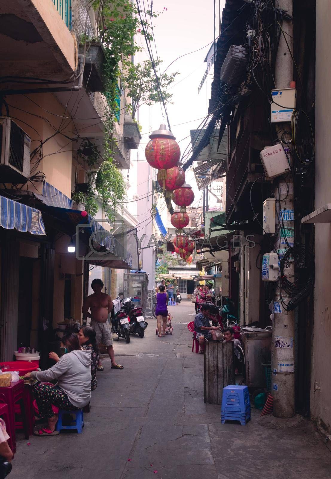 Royalty free image of 2019-11-10 / Ho Chi Minh City, Vietnam - Everyday life scene. Narrow back alley in a poor area of the city. by hernan_hyper