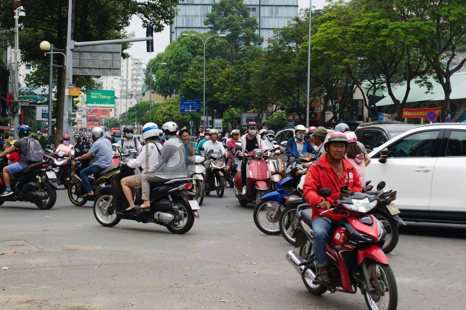 Royalty free image of 2019-11-10 / Ho Chi Minh City, Vietnam - Urban scene in rush hour. Motorcycles flood the chaotic traffic flow of the city. by hernan_hyper