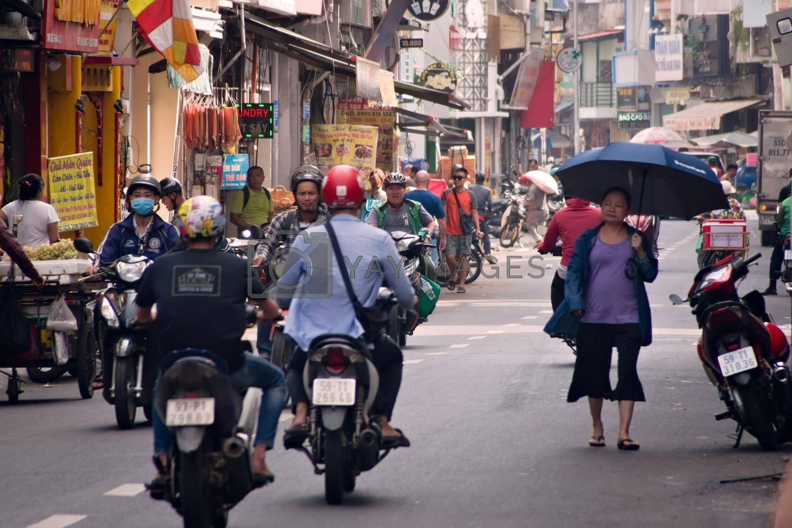 Royalty free image of 2019-11-12 / Ho Chi Minh City, Vietnam - Urban scene in a city street. by hernan_hyper