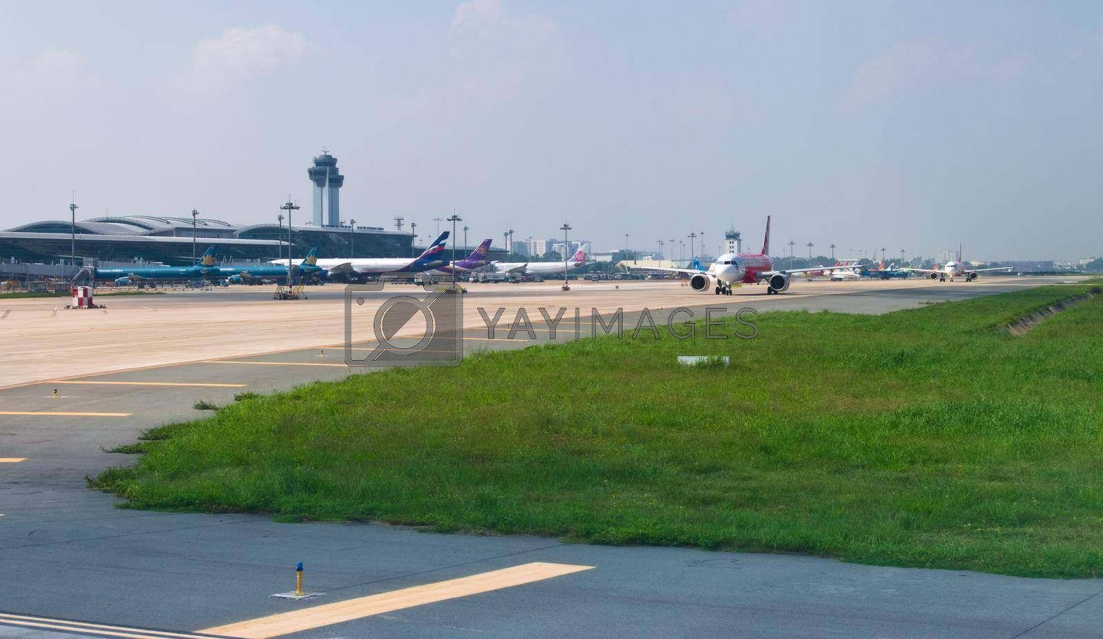 Royalty free image of 2019-11-14 / Ho Chi Minh City, Vietnam - Airliners queue up in the taxiway of the airport, awaiting authorization to take off. by hernan_hyper