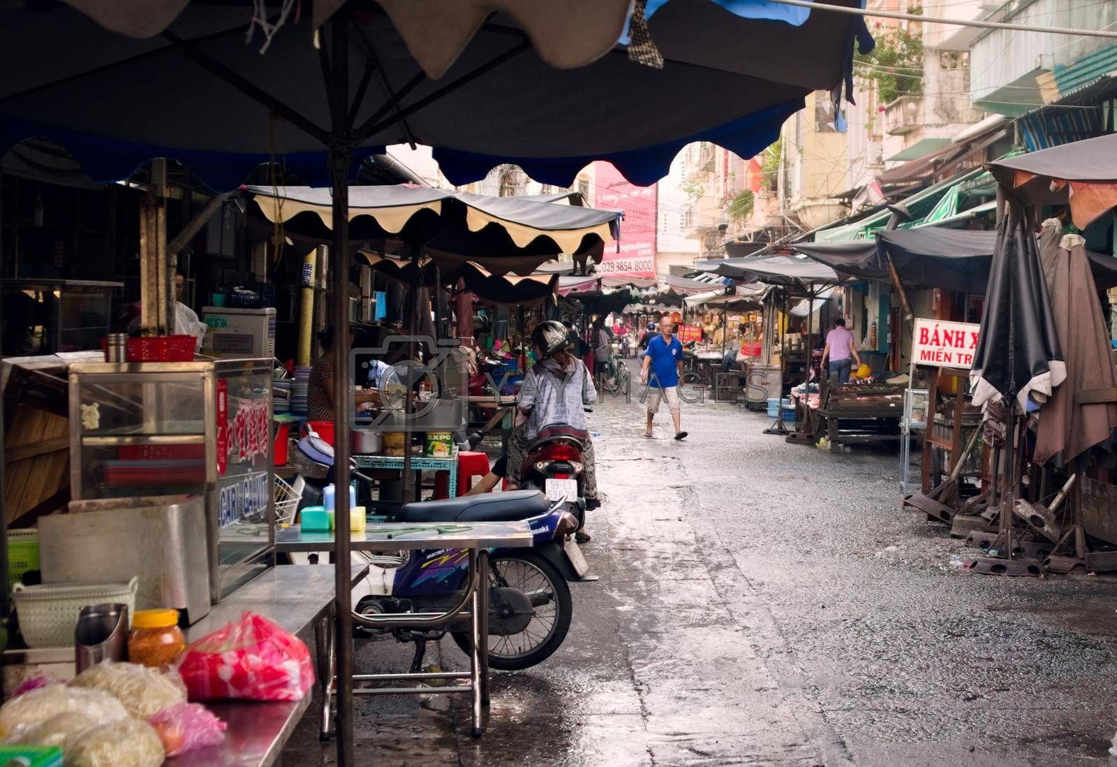 Royalty free image of 2019-11-13 / Ho Chi Minh CIty, Vietnam - A dirty street food market in a poor area of the city. by hernan_hyper