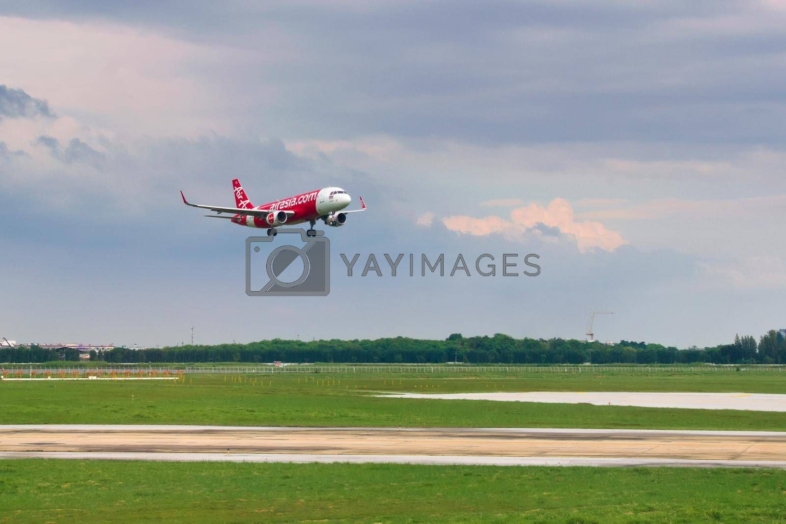 Royalty free image of 2019-11-14 / Ho Chi Minh City, Vietnam - An Air Asia airliner lining up on the final approach for landing. by hernan_hyper