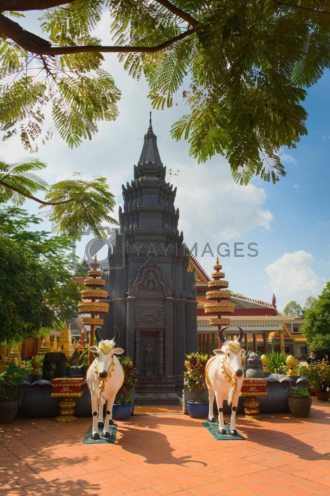 Royalty free image of 2019-11-16 / Siem Reap, Cambodia - Black stupa in Wat Preah Prom Rath, a buddhist temple complex built in the 13th century. by hernan_hyper