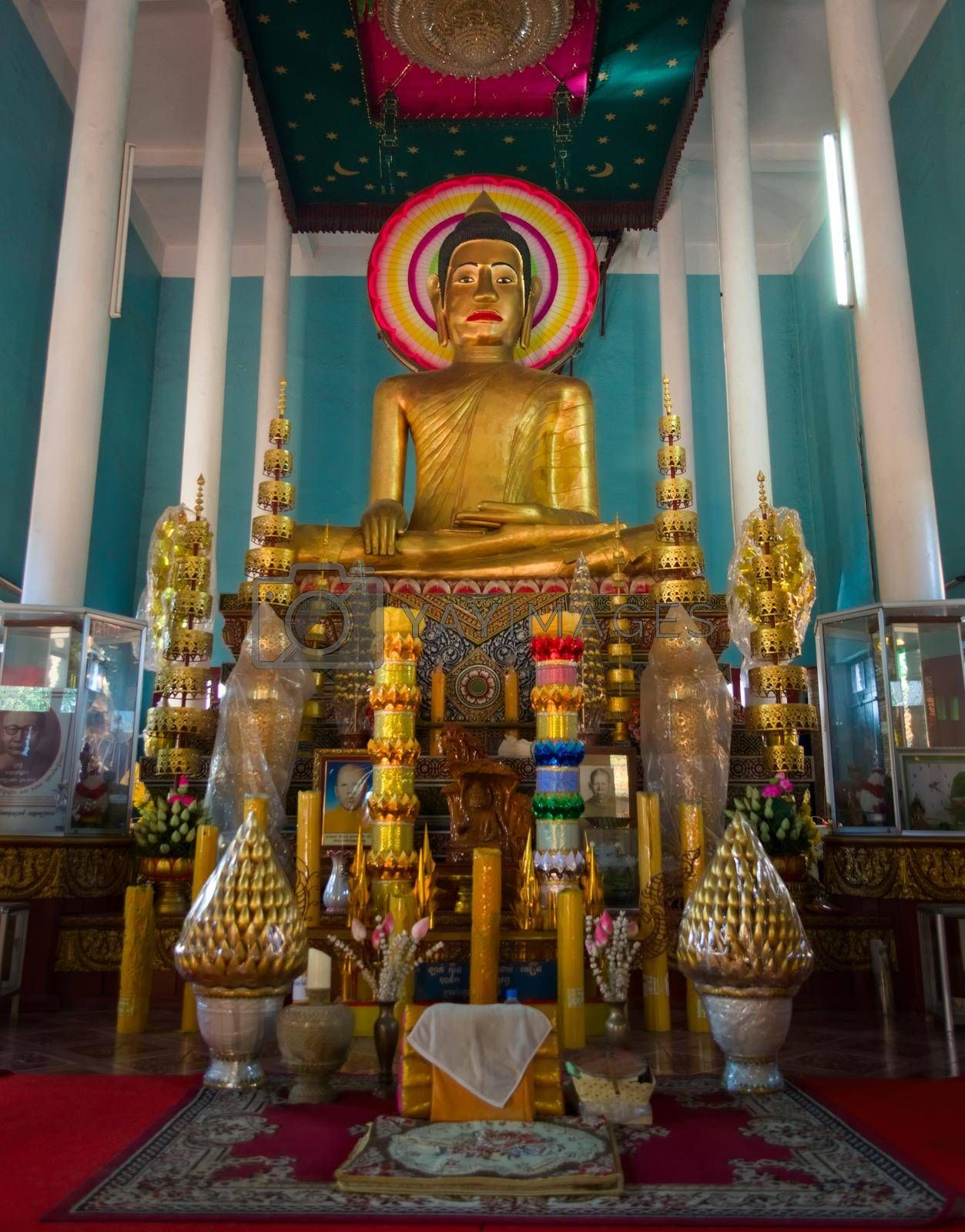 Royalty free image of 2019-11-16 / Siem Reap, Cambodia - Golden statue of Buddha in Wat Preah Prom Rath, a buddhist complex built in the 13th century. by hernan_hyper