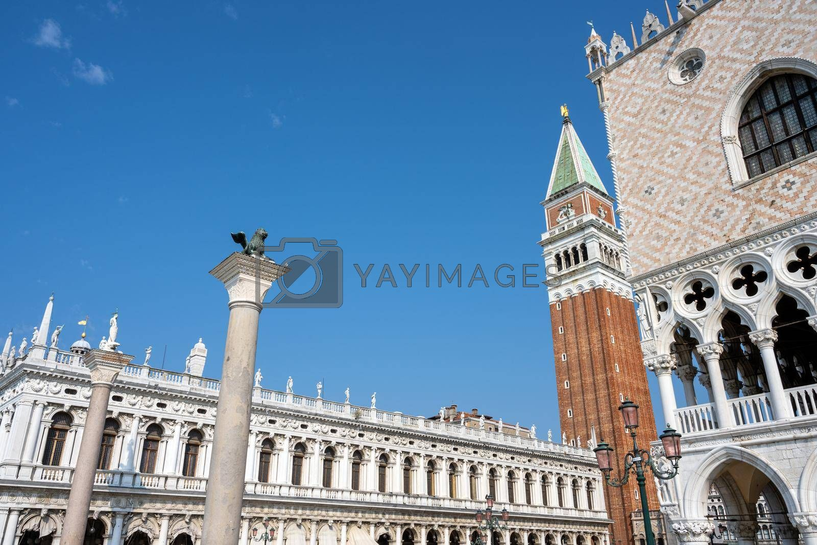 Royalty free image of Part of the famous Doges Palace with the Campanile and the Marciana Library by elxeneize
