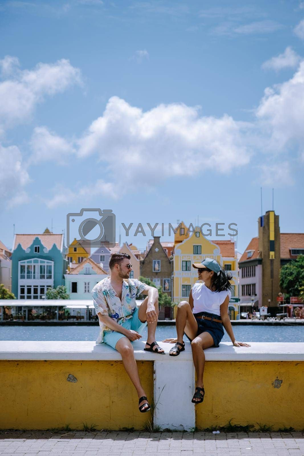 Curacao, Netherlands Antilles View of colorful buildings of downtown Willemstad Curacao Caribbean Island, couple men and woman mid age visiting Willemstad