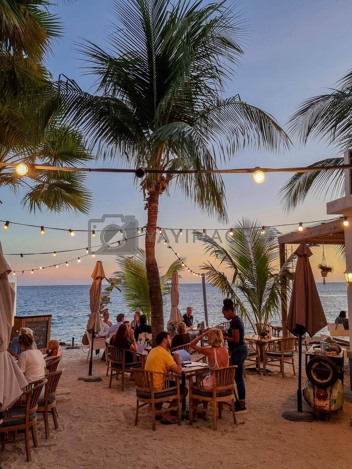 Curacao, Netherlands Antilles March 2021,People dining on the beach Curacao Caribbean Island, Colorful restored colonial buildings in Pietermaai