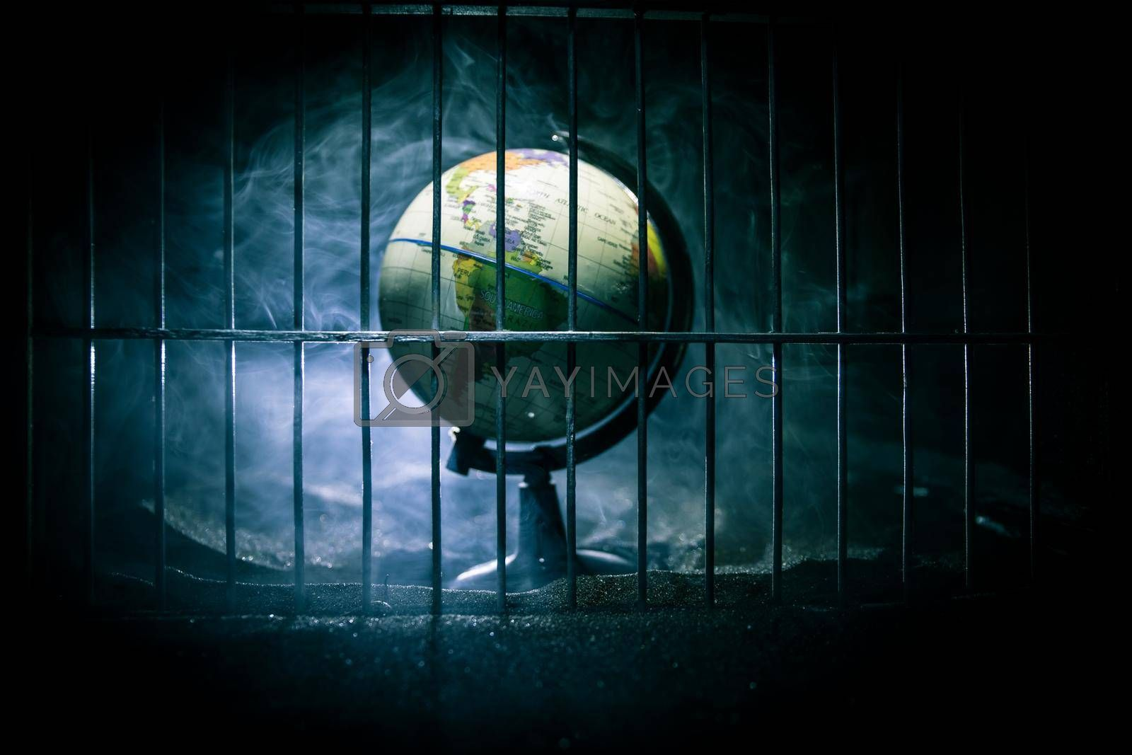 Corona virus lockdown creative concept. Planet earth trapped inside old prison. Creative artwork decoration. Selective focus