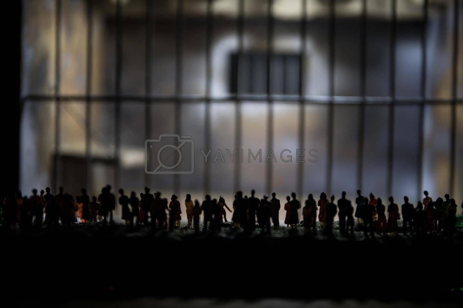 People and police government power concept. Crowd looking on prison miniature. Creative artwork decoration. Selective focus.