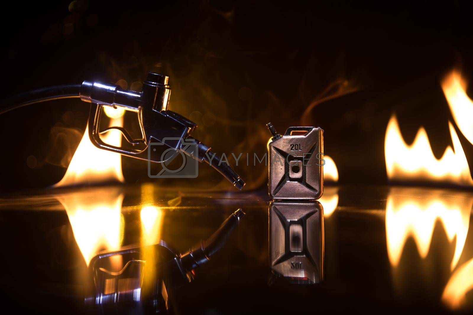 Creative concept. Silhouette of gasoline pistol miniature on dark toned foggy background. Close up. Industrial decorated elements on background. Selective focus